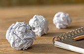 ball paper with notebook on wooden table. with copy space for text.