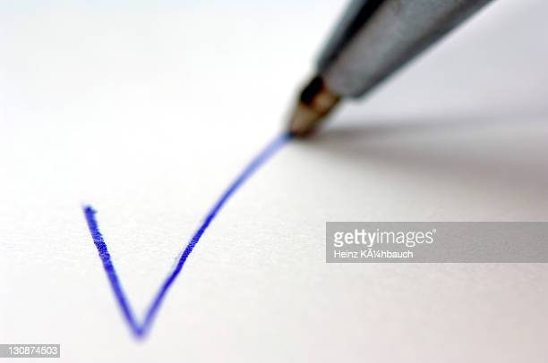 Ball pen writing a checkmark