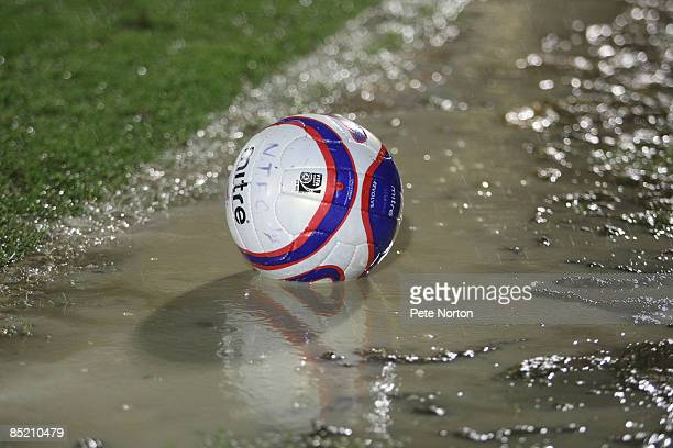 A ball sits in a puddle of water on the touchline after the abandonment of the Coca Cola League One Match between Northampton Town and Milton Keynes...