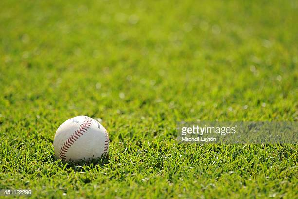 A ball sits in the grass before a baseball game between the Baltimore Orioles and the Chicago White Sox on June 23 2014 at Oriole Park at Camden...