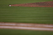 A ball sits next to the pitching mound during between the Miami Marlins and the Tampa Bay Rays the game at Marlins Park on April 10 2015 in Miami...