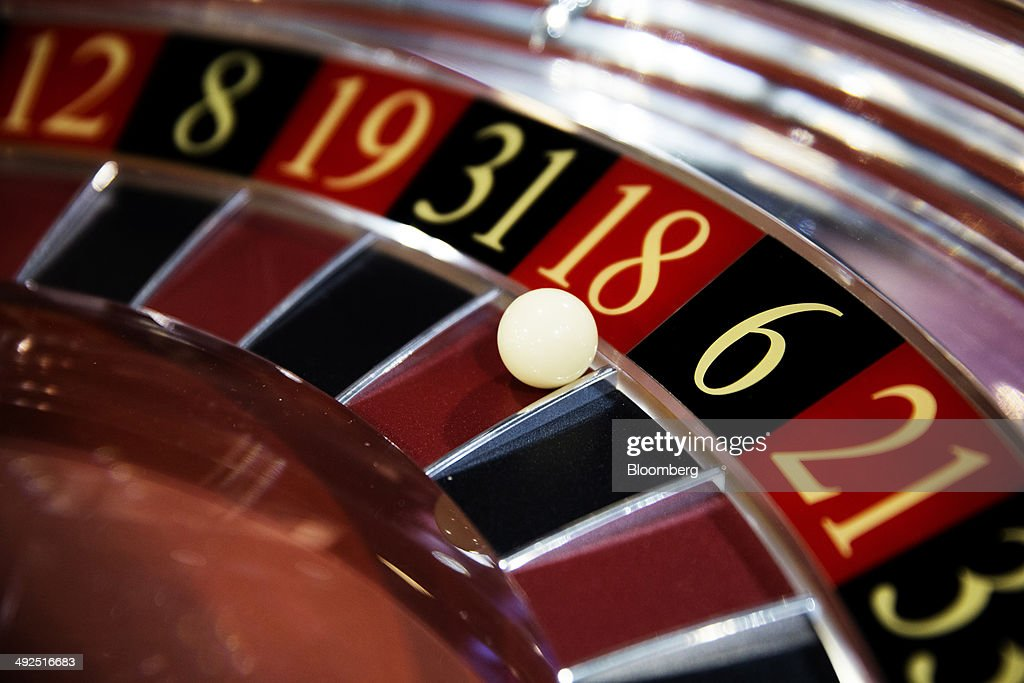 A ball sits on a roulette wheel in the Cammegh Ltd booth at the Global Gaming Expo inside the Venetian Macao resort and casino operated by Sands...