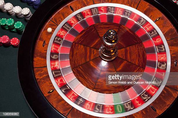 Ball spinning on roulette table