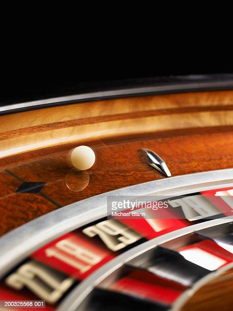 Ball spinning on roulette wheel, close-up (blurred motion)