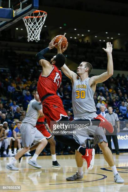 Ball State Cardinals forward Franko House goes in for a layup against Toledo Rockets forward Luke Knapke during a regular season basketball game...