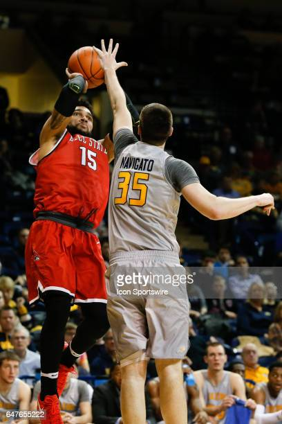 Ball State Cardinals forward Franko House shoots over Toledo Rockets forward Nate Navigato during a regular season basketball game between the Ball...