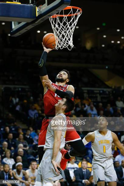 Ball State Cardinals forward Franko House shoots over Toledo Rockets guard Jordan Lauf during a regular season basketball game between the Ball State...
