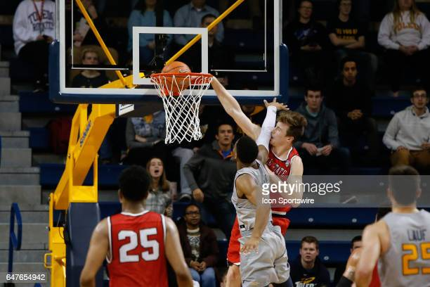 Ball State Cardinals guard Josh Thompson dunks the ball over Toledo Rockets guard Jonathan Williams during a regular season basketball game between...