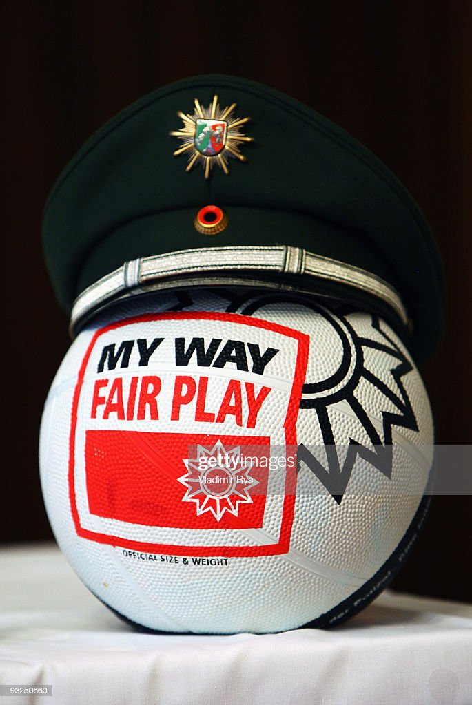 A ball with a police cap is seen presented on the speakers table ahead a press conference to present the results of an investigation into allegations...