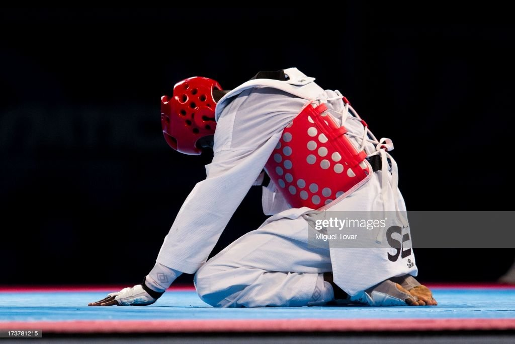 Balla Dieye of Senegal grimaces in pain during a Men's -68 kg combat against Hun Kim of Korea of WTF World Taekwondo Championships 2013 at the exhibitions Center on July 17, 2013 in Puebla, Mexico.