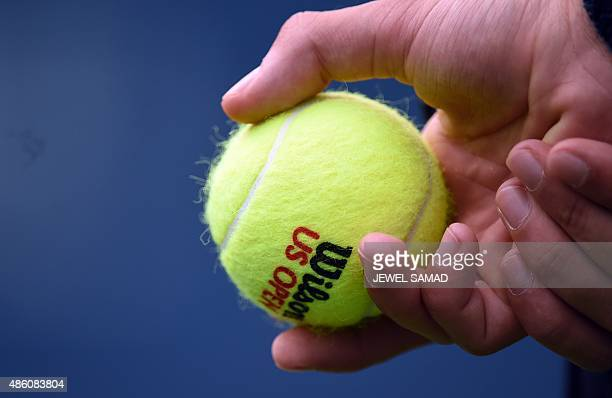 A ballboy holds a tennis ball during a round 1 match of the US Open at USTA Billie Jean King National Tennis Center in New York on August 31 2015 AFP...