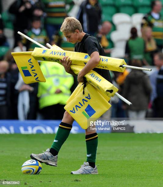 A ballboy holds an Aviva branded corner posts as he collects them after the game