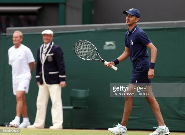 A ballboy is given a turn at a shot during USA's John McEnroe and Patrick McEnroe's game against Australia's Paul McNamee and Peter McNamara in their...