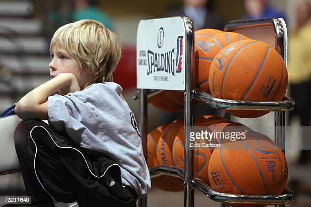 A ballboy sits next to a rack of official basketballs during the 2007 NBA DLeague Martin Luther King Jr Showcase between the Sioux Falls Skyforce and...