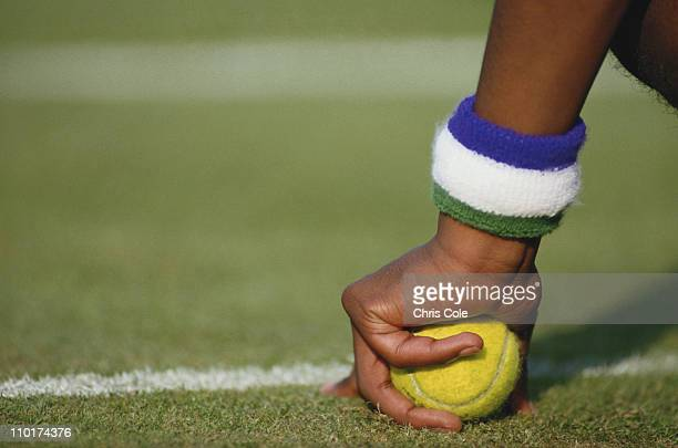 A ballboy with his Wimbledon sweatbands holds a tennis ball in preparation during the Wimbledon Lawn Tennis Championships on 1st July 1987 at the All...