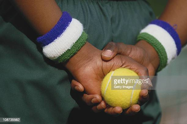 A ballboy with his Wimbledon sweatbands holds a tennis in preparation during the Wimbledon Lawn Tennis Championships on 1st July 1987 at the All...