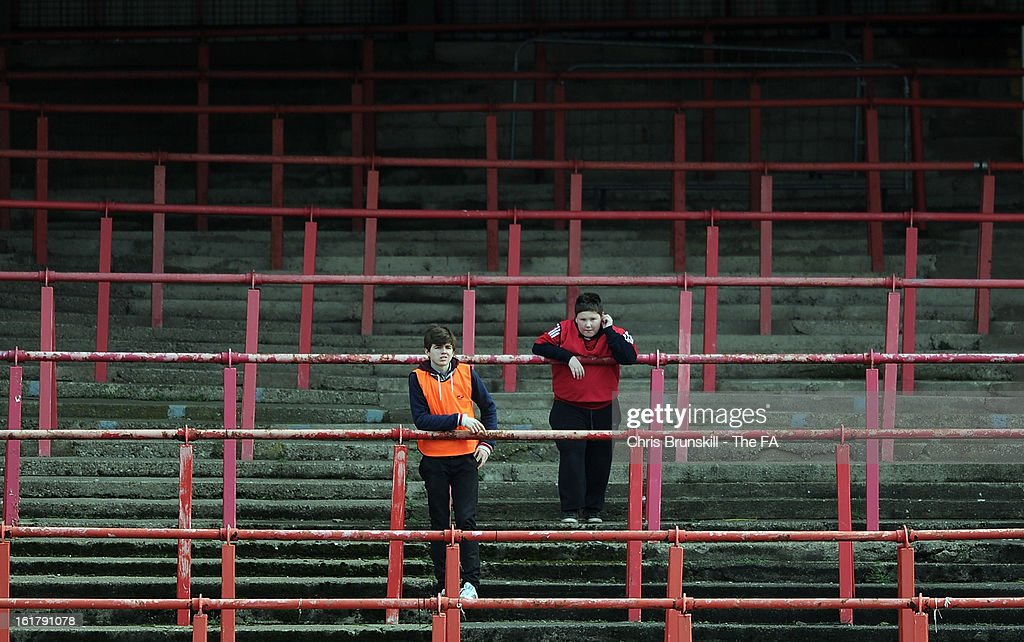 Ballboys watch on from an empty stand during the FA Trophy Semi-Final match between Wrexham and Gainsborough Trinity at the Racecourse Ground on February 16, 2013 in Wrexham, Wales.