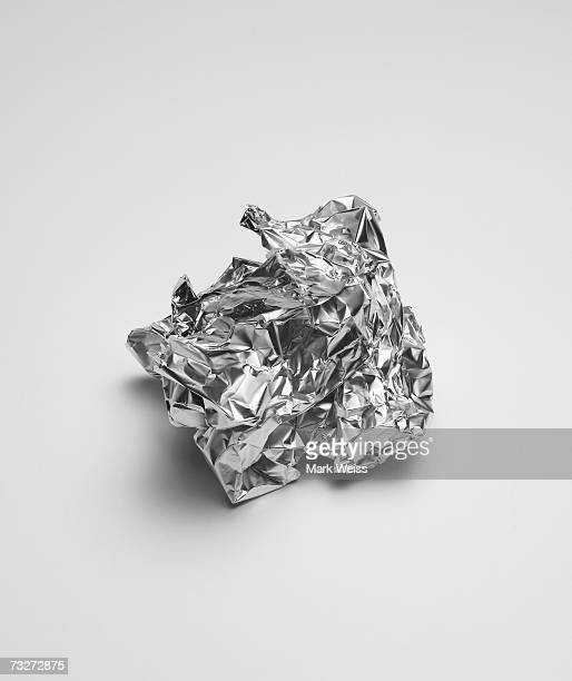 'Balled up aluminum foil, close-up, elevated view'