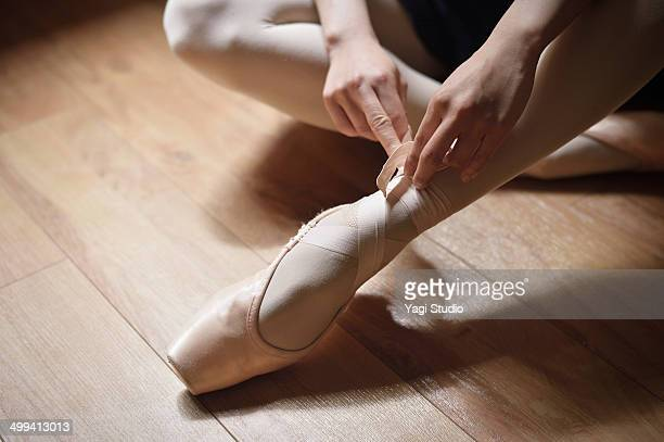 Ballerina adjusting shoes