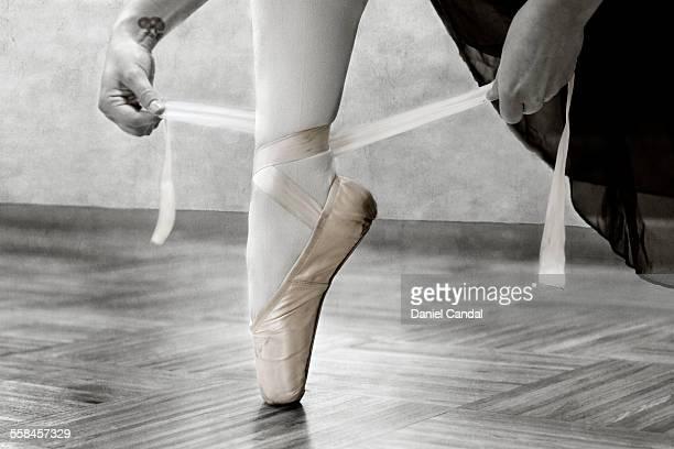 Ballerina adjusting shoes