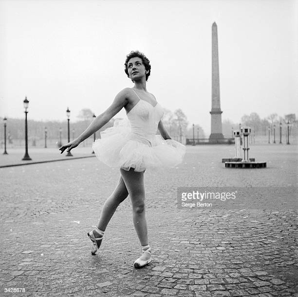Ballerina Christianne Gaulthier a dancer at the Moulin Rouge fulfils a lifelong dream to dance through the deserted streets of Paris at the crack of...