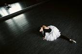 Ballerina dancing indoors