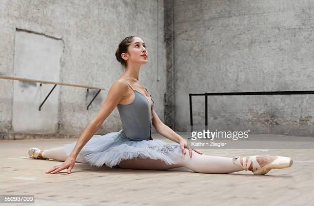 ballerina doing the splits on the floor