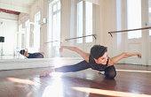 ballerina exercising in rehearsal room