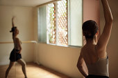Ballerina exercising in studio