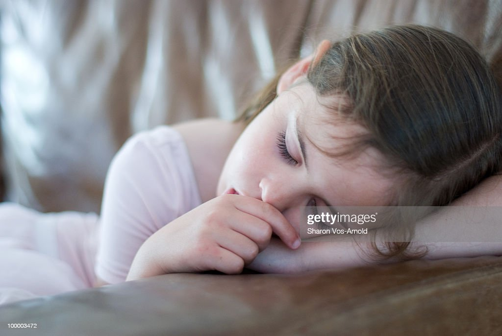 Ballerina girl asleep on the sofa. : Stock Photo