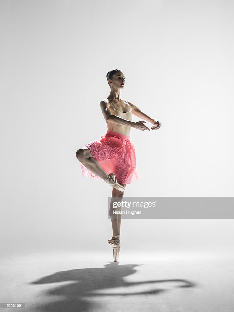 Ballerina in passe with arms in first position
