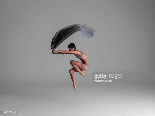 Ballerina in the air with fabric
