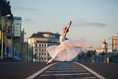 Russian ballerina in tutu dancing in the center of Moscow