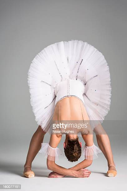 Ballerina in tutu stretching