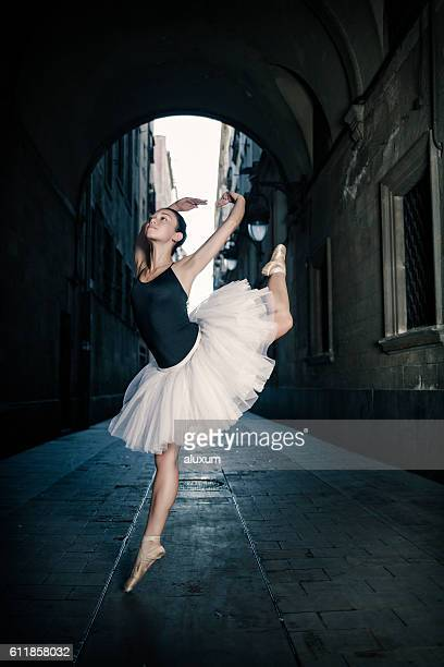 Ballerina jumping in the city