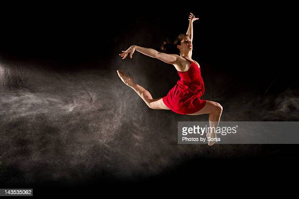 Ballerina leaping into air