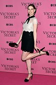 US ballerina Mary Helen Bowers poses for pictures on the pink carpet with an unidentified guest upon arrival for the 2014 Victoria's Secret Fashion...