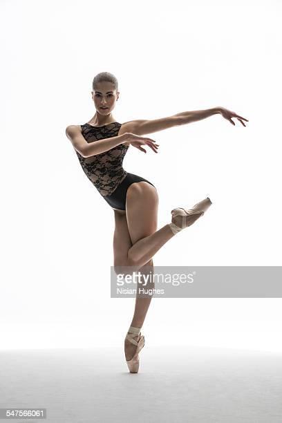 ballerina on pointe looking at camera