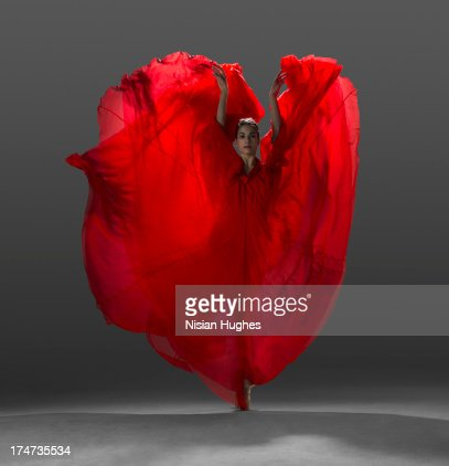 Ballerina on pointe with red dress floating