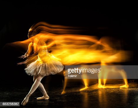 Ballerina on stage with ghosts : Stock Photo
