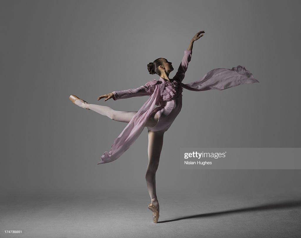 Ballerina performing arabesque on pointe