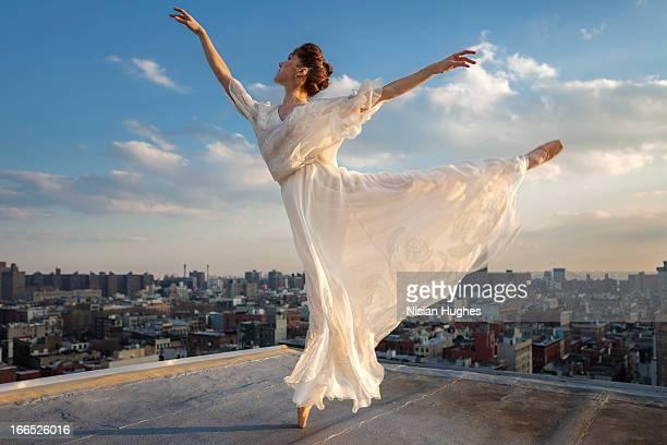 Ballerina performing Arabesque on roof