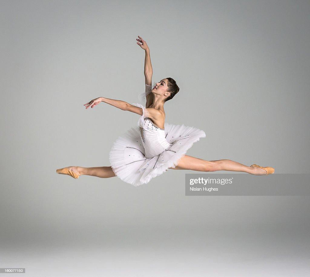 ballerina performing grand jeté : Stock Photo