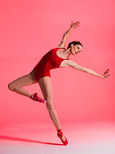 Ballerina performing in red pointe shoes
