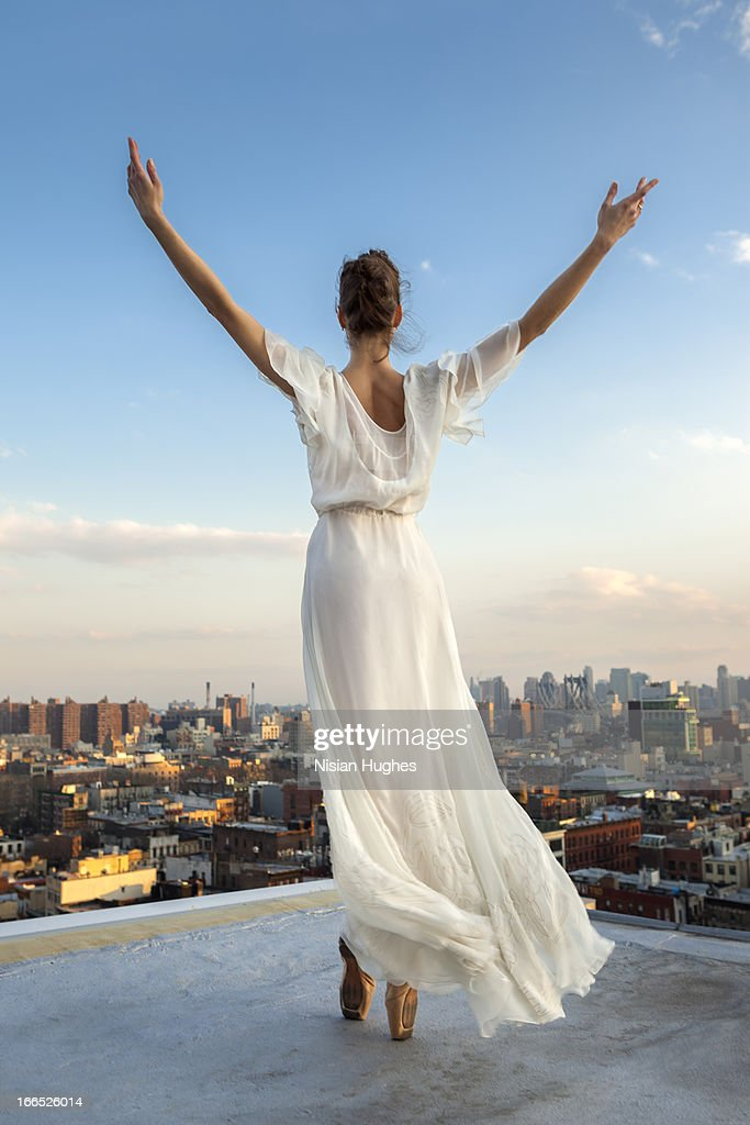 Ballerina performing Relevé on pointe on roof