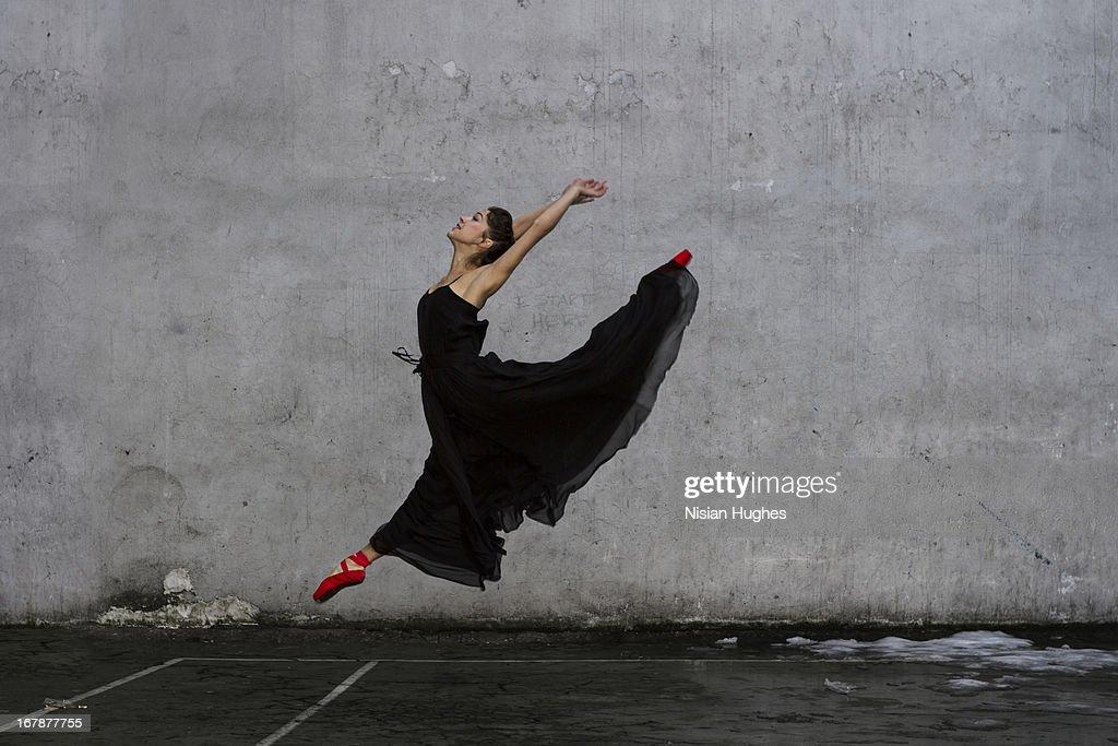 Ballerina performing Sissone outside