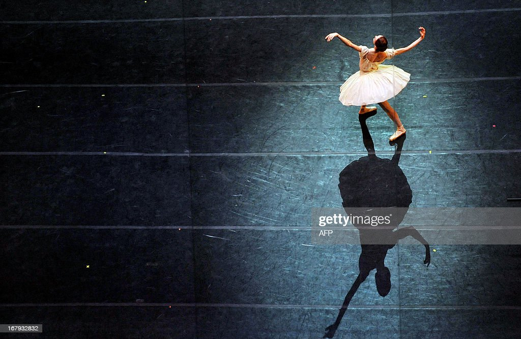 A ballerina performs during a dress rehearsal on May 1, 2013 on the eve of the Grand gala dedicated to the opening of the new stage Mariinsky II theatre in St. Petersburg. Russia's famous Mariinsky theatre in Saint Petersburg was to inaugurate a new ballet and opera house on May 2 in an event coinciding with the 60th birthday of its hugely ambitious and well-connected director Valery Gergiev.