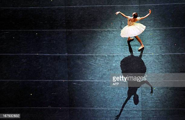 A ballerina performs during a dress rehearsal on May 1 2013 on the eve of the Grand gala dedicated to the opening of the new stage Mariinsky II...