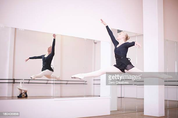 Ballerina practicing mid air jump