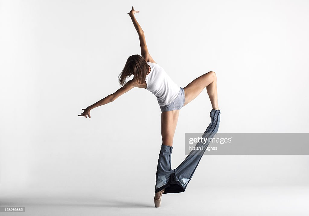 Ballerina pulling off her pants : Stock Photo